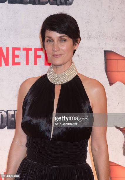 CarrieAnn Moss arrives for the Netflix premiere of Marvel's 'The Defenders' on July 31 2017 in New York / AFP PHOTO