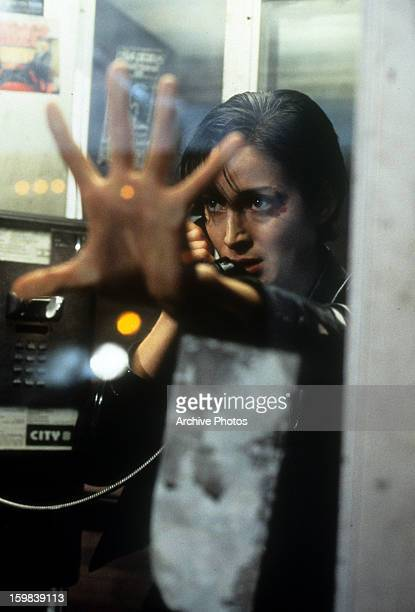 CarrieAnne Moss in phone booth in a scene from the film 'The Matrix' 1999