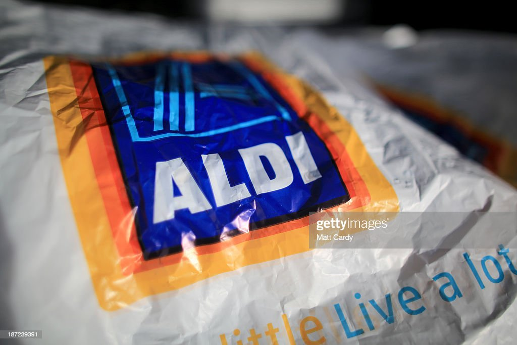 Carrier bags from a branch of the budget supermarket Aldi are seen on November 7, 2013 in Bristol, England. As the German chain opens its 500th store in the affluent Bury St Edmunds, some retail experts are claiming that the low-cost supermarket is trying to attract more affluent shoppers, in particular by offering large discounts on luxury items.