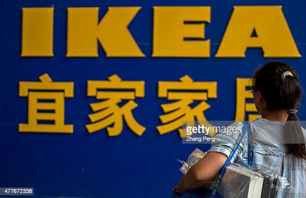 Carries Ikea's shopping bag a girl stands in front of the big logo of IKEA IKEA Beijing Xihongmen Store located in a large shopping center named...