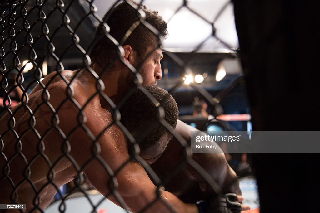 Carrington Banks pushes Sabah Homasi up against the cage in their bout during the filming of The Ultimate Fighter American Top Team vs Blackzilians...