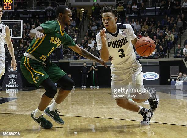 Carrington Ward of the Norfolk State Spartans defends as Carsen Edwards of the Purdue Boilermakers drives to the basket at Mackey Arena on December...