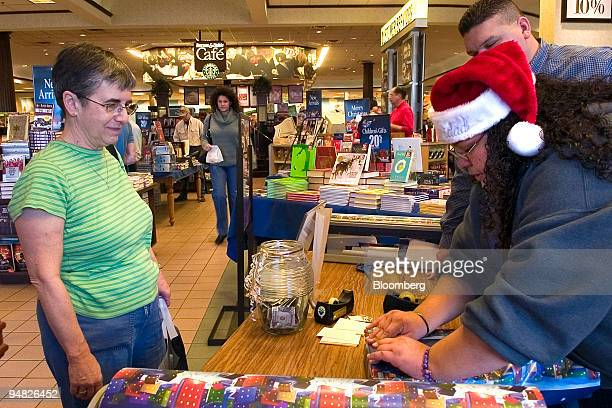 Carrol Kunkel left takes advantage of the free gift wrapping by Ashley Pena at Barnes Noble Booksellers in Corpus Christi Texas on Friday December 23...