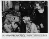 Carroll Baker holds Kyle Richards as LynnHolly Johnson and Bette Davis look scared in a scene for the Walt Disney movie 'The Watcher in the Woods'...