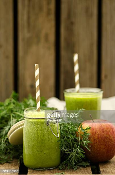 Carrot apple smoothie, preserving jar with drinking straw