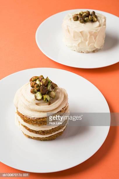 Carrot cakes on plates, studio shot