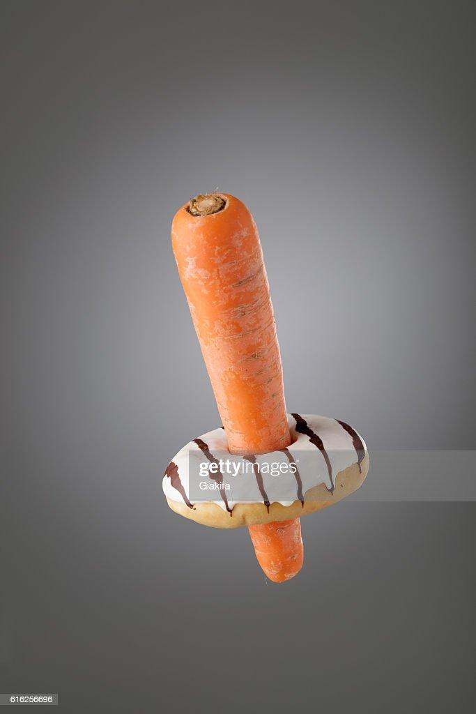 Carrot inside donuts : Foto de stock