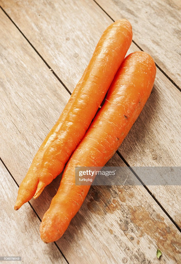 carrot on wooden background : Stock Photo