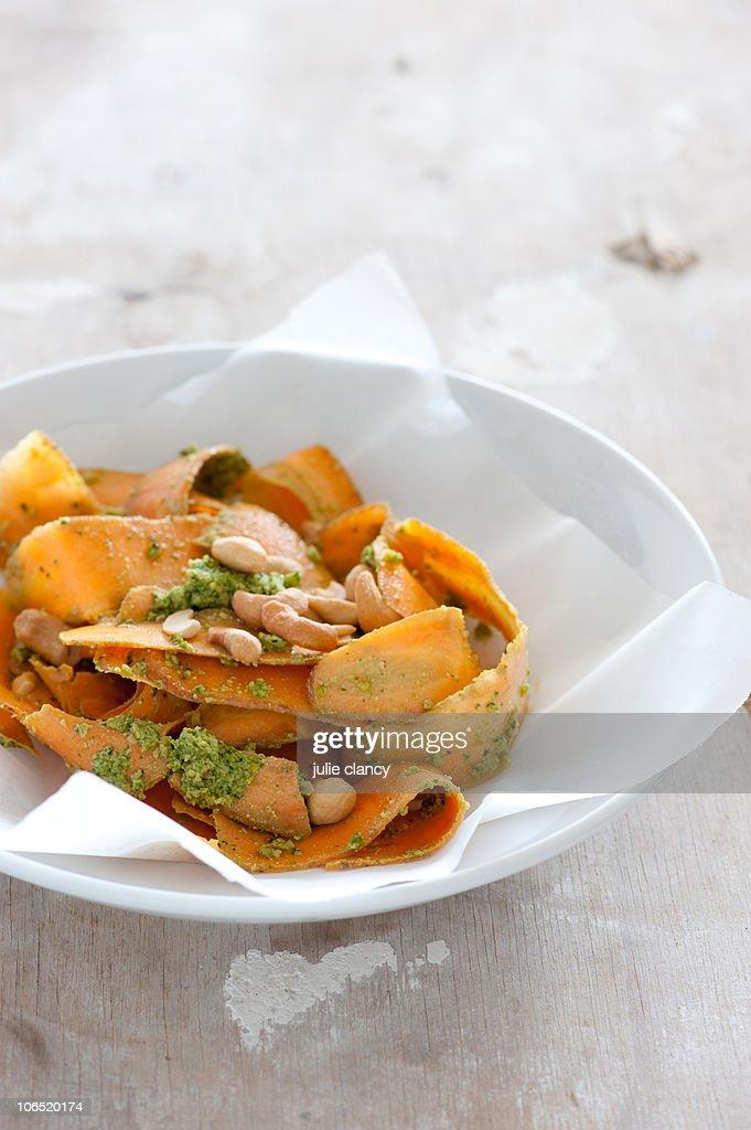 Carrot salad with pesto dressing : Stock Photo
