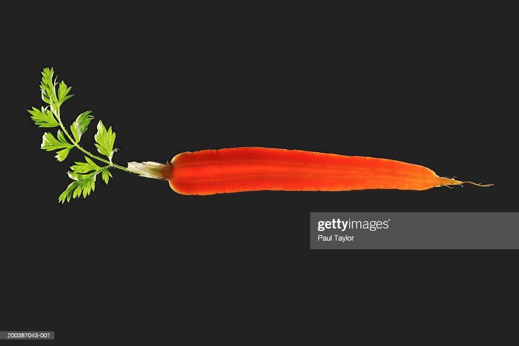 Carrot sliced lengthwise : Stock Photo