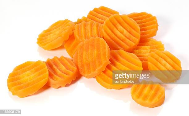 Carrot slices of different sizes isolated in white