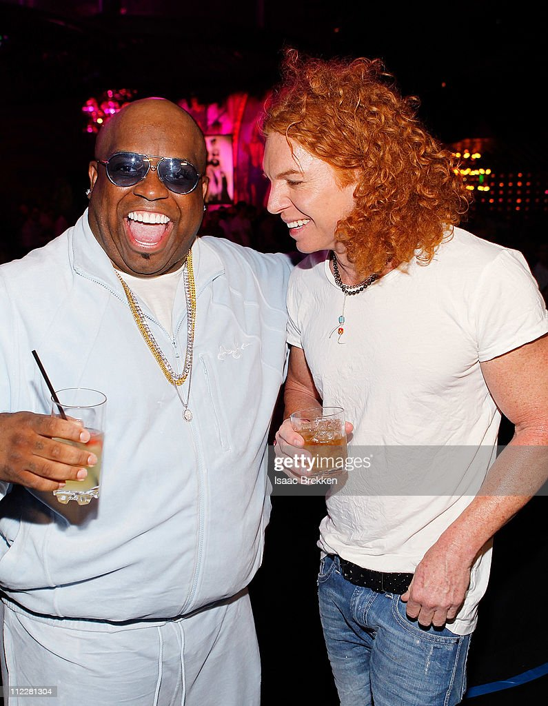 Carrot Top (R) and Ceelo Green attend the grand opening of Gallery Nightclub at the Planet Hollywood Resort & Casino on April 16, 2011 in Las Vegas, Nevada.