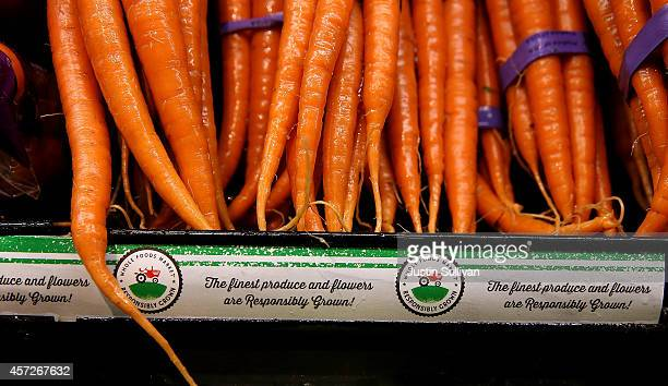 Carrots are displayed in the produce section at a Whole Foods market on October 15 2014 in San Francisco California Upscale grocery chain Whole Foods...
