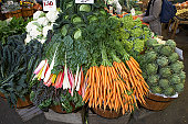 Carrots, chard, artichokes, greens and cauliflowers on market stall