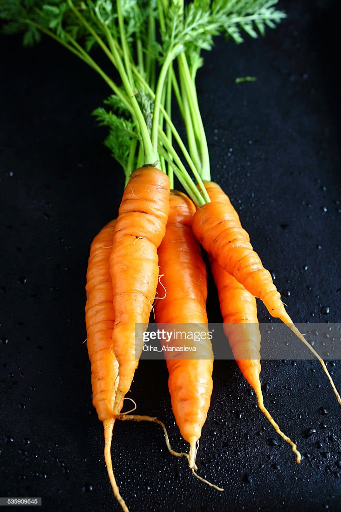 Carrots on a baking sheet : Stock Photo
