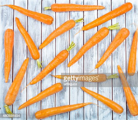 Carrots on wooden background : Stock Photo