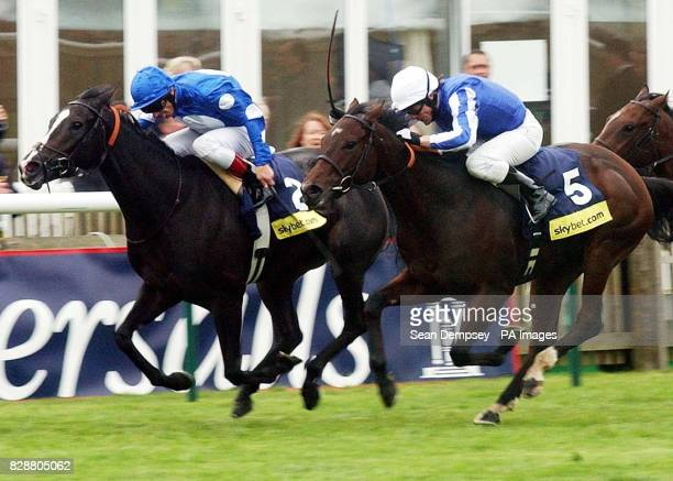 Carry On Katie ridden by Frankie Dettori finishes ahead Majestic Desert to win the Sky Bet Cheveley Park Stakes over the Rowley Mile at Newmarket...