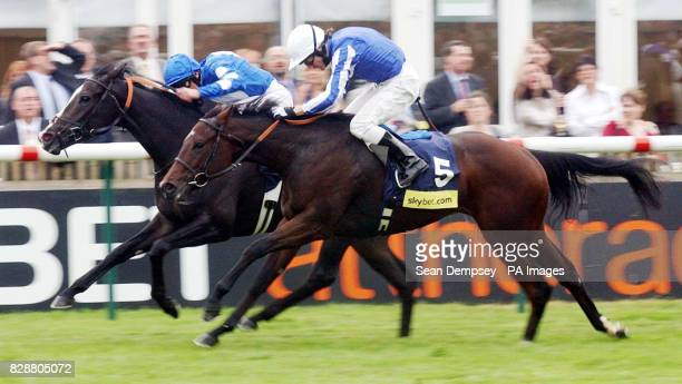 Carry On Katie ridden by Frankie Dettori finishes ahead of Majestic Desert to win the Sky Bet Cheveley Park Stakes over the Rowley Mile at Newmarket...