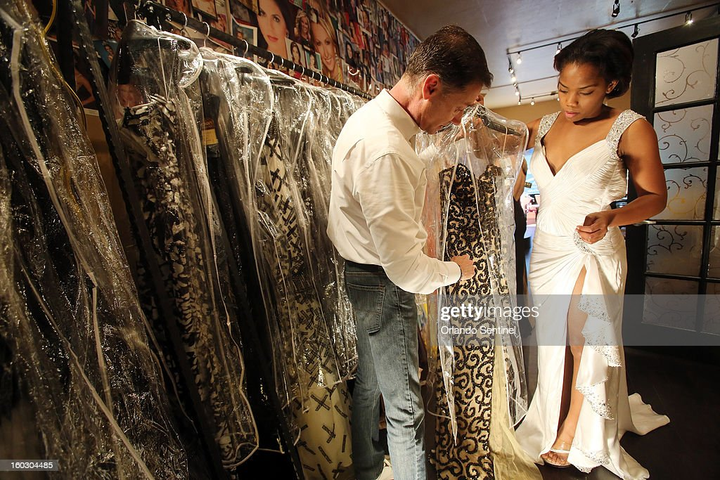 Carry O'Neal, co-owner of Regalia in Orlando, Florida, helps Louissa Nevy, 20, on Wednesday, January 23, 2013. Nevy will be competing in the Citrus Pageant. The Thornton Park shop outfitted the winner, first and second runners up at the Miss America pageant.