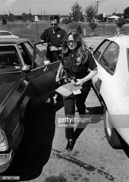 Carrying records and gear Officer Heather Rodriguez leaves her car and heads for district headquarters Credit Denver Post Inc