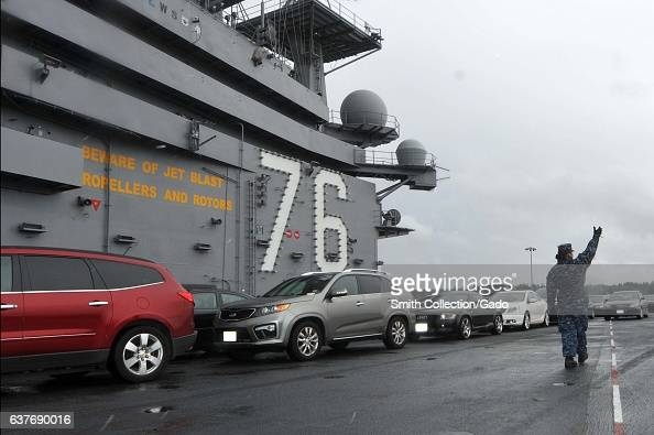 Carrying sailors' cars aircraft carrier USS Ronald Reagan departs from Bremerton Washington for San Diego following over a year of maintenance Puget...