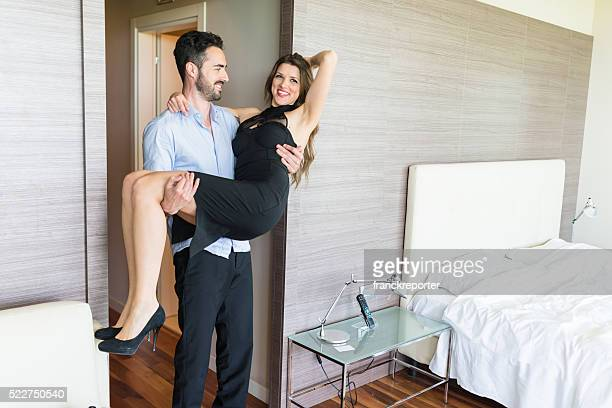carrying the wife in the hotel room