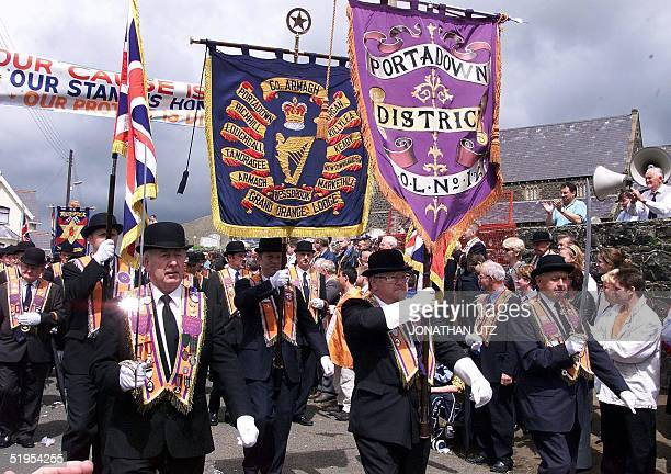 Carrying their banners loyalist Orangemen go down the hill past the Drumcree Parish Church on their march from Portadown to Drumcree 09 July 2000 The...