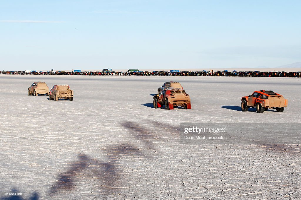 Cars #303, 301, 302,#308 and #310 start their race on day 8 of the Dakar Rallly on the Salar de Uyuni or Uyuni Salt Flats on January 11, 2015 in Uyuni, Bolivia.