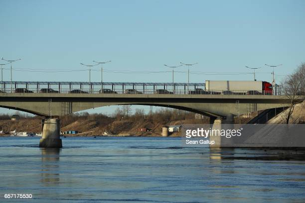 Cars and a truck wait to cross from Estonia into Russia over the Narva River on March 23 2017 at Narva Estonia Estonia is a member of the European...