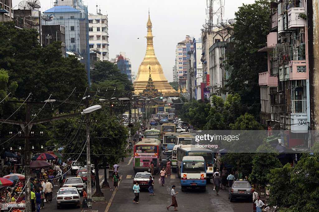 Cars and buses line up near the Sule Pagoda, in downtown Yangon, Myanmar, on Sunday, Nov. 18, 2012. President Barack Obama will become the first sitting U.S. president to visit Myanmar when he travels to Yangon on Nov. 19 to meet President Thein Sein and Aung San Suu Kyi, the opposition leader who spent more than 15 years under house arrest before the country shifted to democracy after decades of military rule. Photographer: Dario Pignatelli/Bloomberg via Getty Images