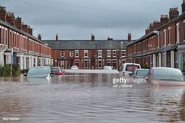 Cars and houses are submerged as Storm Desmond causes flooding on December 6 2015 in Carlisle England Storm Desmond has brought severe disruption to...