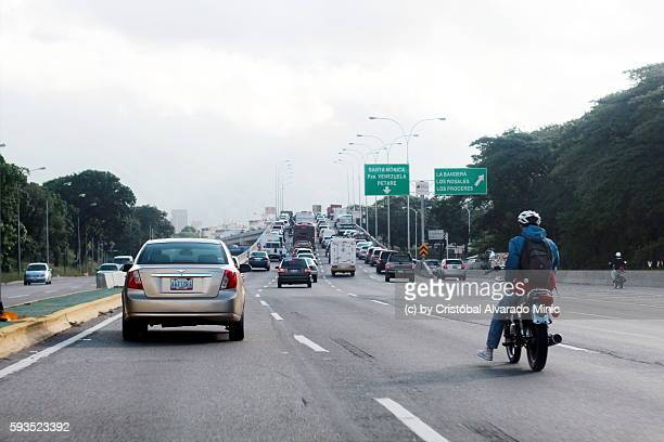Cars And Motorbiker On Highway