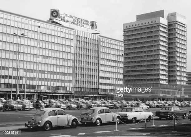 Cars and office blocks on KarlMarxAllee East Berlin German Democratic Republic 1972