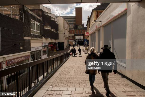 Cars and people pass shops along the high street on April 25 2017 in Newport Wales The British Prime Minister Theresa May's visit to South Wales...