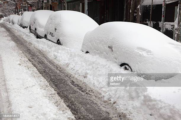 Cars and streets covered in snow
