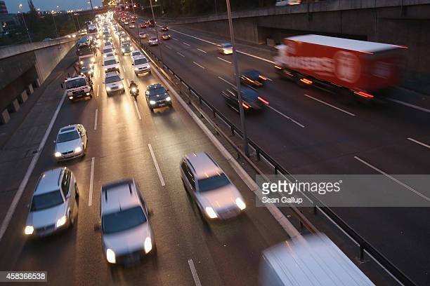 Cars and traffic fill the A100 ring highway at dusk on November 3 2014 in Berlin Germany Germany is heatedly debating the introduction of highway...