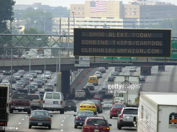 Cars and trucks drive along Interstate 75/85 June 25 2003 in Atlanta Georgia The first 'Code Red' smog alert was of the year was announced with...