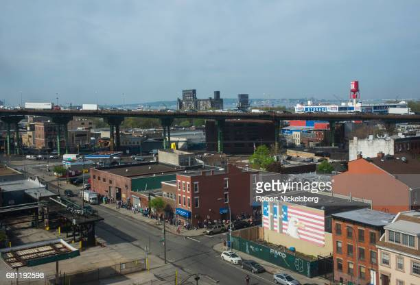 Cars and trucks negotiate traffic along the elevated section of the BrooklynQueens Expressway April 29 2017 in the Brooklyn borough of New York City...