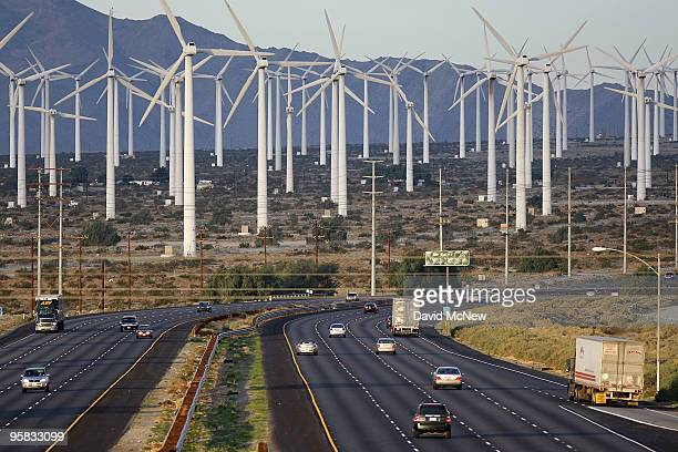 Cars and trucks on the Interstate 10 freeway pass wind mills on January 17 2010 near of Palm Springs California The San Andreas earthquake fault...