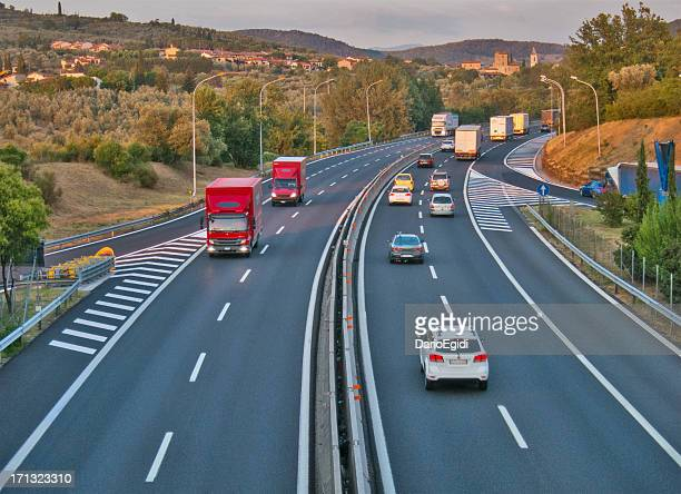 Cars and trucks travelling along the italian motorway