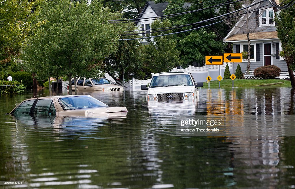 Cars are abandoned on a flooded Brooke Ave following heavy rains and flash flooding on August 13, 2014 in Bayshore, New York. The south shore of Long Island along with the tri-state region saw record setting rain that caused roads to flood entrapping some motorists.