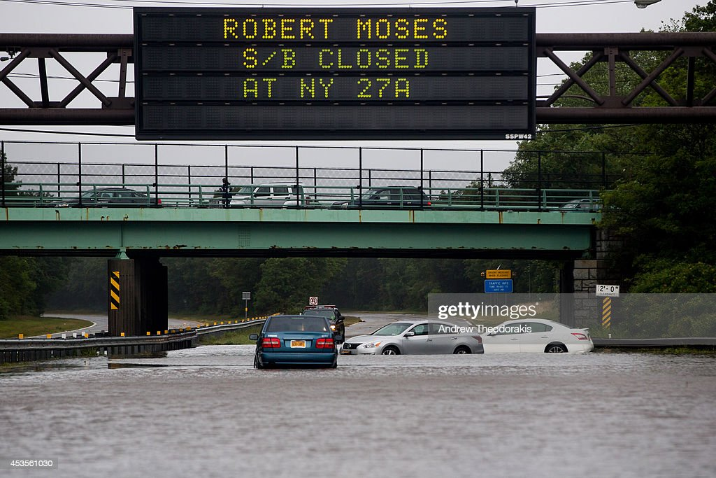 Cars are abandoned on the Southern State Parkway following heavy rains and flash flooding August 13, 2014 in Islip, New York. The south shore of Long Island along with the tri-state region saw record setting rain that caused roads to flood entrapping some motorists.