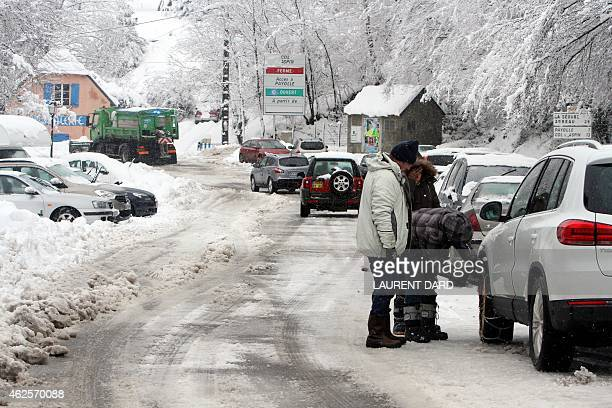 Cars are blocked on January 31 2015 in SainteMarie de Campan waiting for a snowplough to clear the road in the Pyrenees mountains after a snowfall...