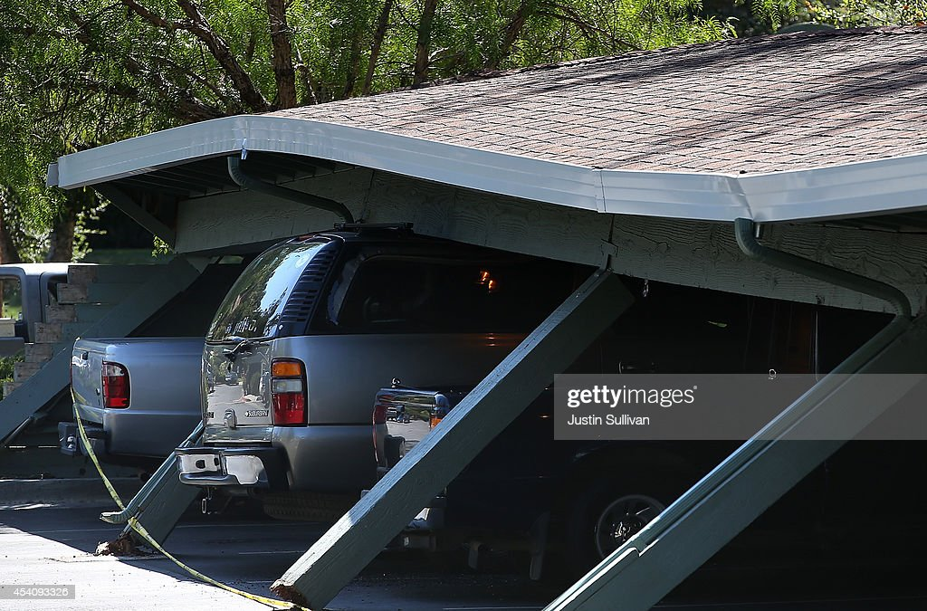 Cars are crushed under a collapsed carport following a 6.0 earthquake on August 24, 2014 in Napa, California. A 6.0 earthquake rocked the San Francisco Bay Area shortly after 3:00 am on Sunday morning causing damage to buildings and sending at least 70 people to a hospital with non-life threatening injuries.