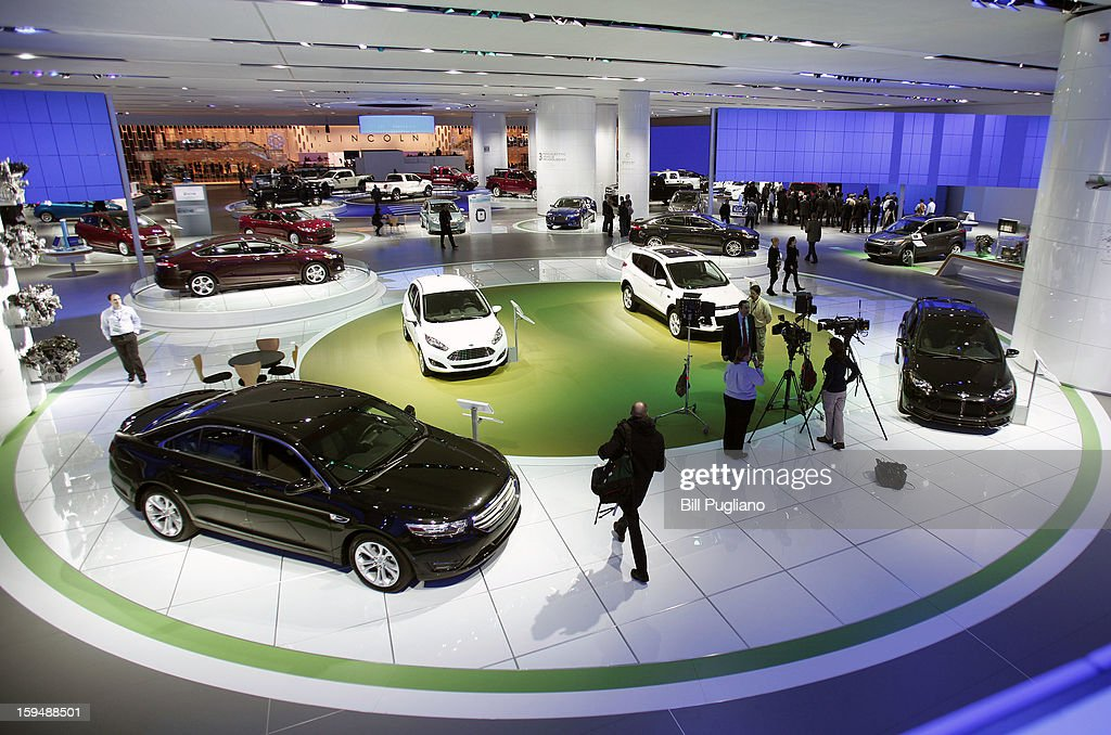 Cars are displayed at the Ford exhibit at the 2013 North American International Auto Show media preview at the Cobo Center January 14, 2013 in Detroit, Michigan. Approximately 6,000 members of the media from 68 countries are attending the show this year. The 2013 NAIAS opens to the public January 19th.