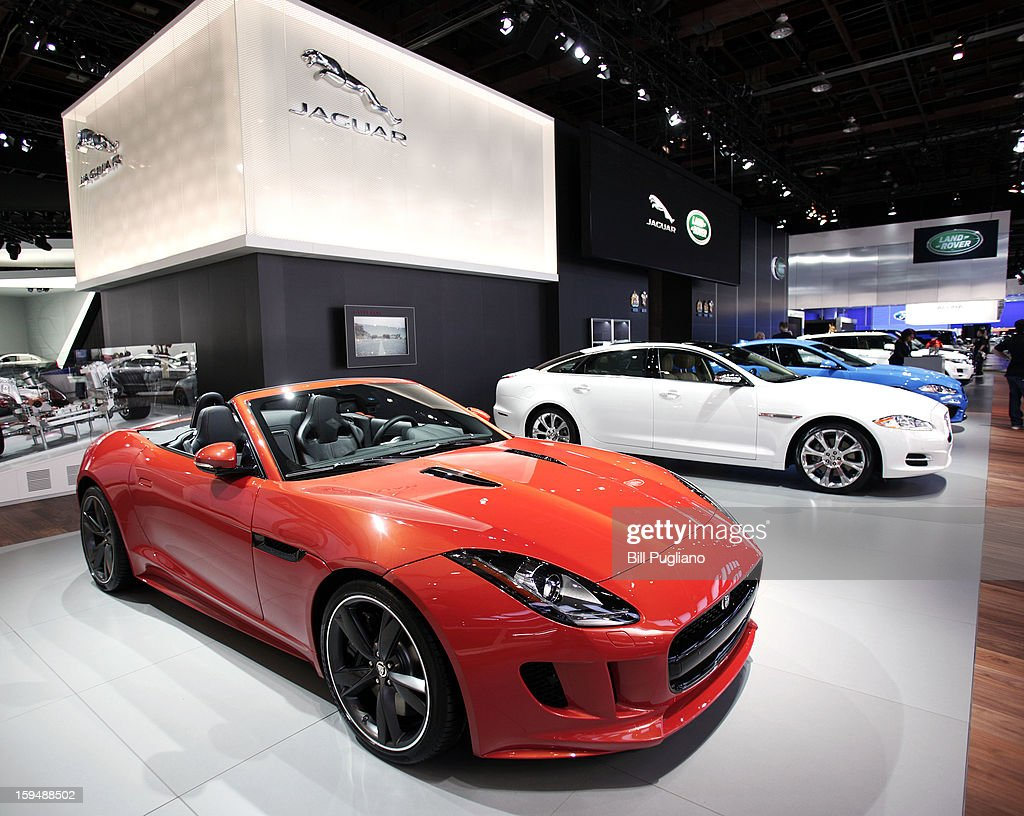 Cars are displayed at the Jaguar exhibit at the 2013 North American International Auto Show media preview at the Cobo Center January 14, 2013 in Detroit, Michigan. Approximately 6,000 members of the media from 68 countries are attending the show this year. The 2013 NAIAS opens to the public January 19th.