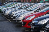 Cars are displayed for sale on the forecourt of a Vauxhall dealership on January 8 2014 in London England Figures from the motor industry have...