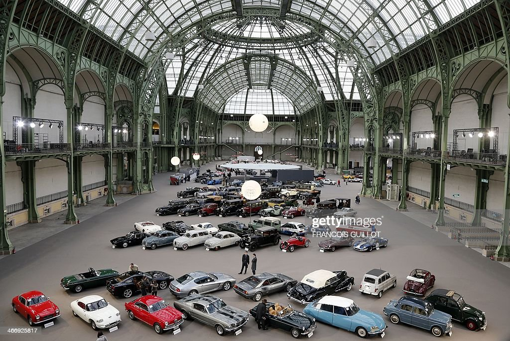 Cars are displayed on February 5, 2014 at the Grand Palais in Paris on the eve of an auction of luxury vintage cars. vintage motor cars, collection motorbikes will be auctionned by British auction house Bonhams on February 6. AFP PHOTO FRANCOIS GUILLOT