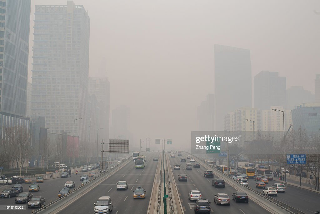 Cars are driving on the overpass of Beijing CBD in the heavy haze This is the first Yellow warning of Beijing's air pollution in 2015 and the hazy...