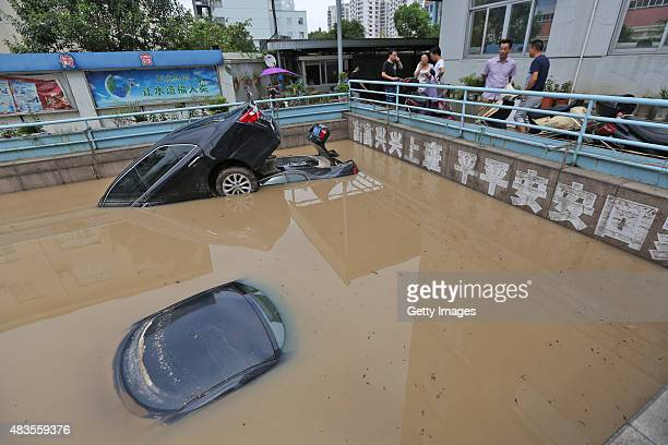 Cars are immersed in water on August 10 2015 in Taizhou Zhejiang Province of China Typhoon 'Soudelor' has brought strong rainfall to China's...